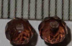 Glasperle Braun geschliffen 4mm