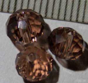 Glasperle Braun geschliffen 6mm